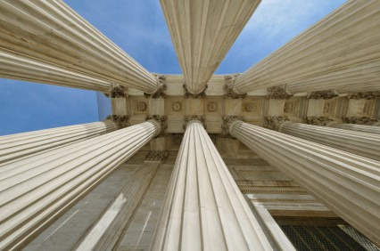 Looking up the pillars of the US Supreme Court through a fisheye lens.