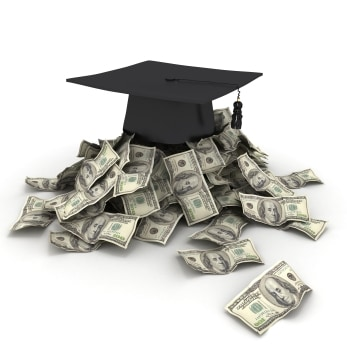 A photograph of Graduation cap on top of stacks of money