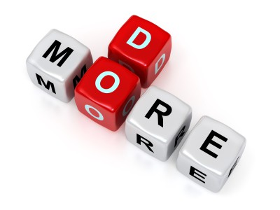"""Photo of dice spelling out """"Do More"""""""