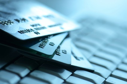 Credit cards on keyboard in blue