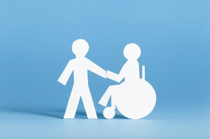 Two stick figures holding hands, one is standing and one is in a wheelchair