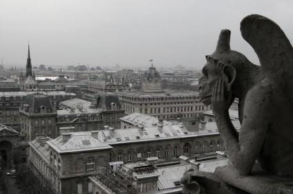 Black and White Photo of Paris with Gargoyle on Notre Dame Cathedral in the foreground.
