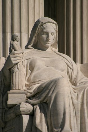 Photo of seated statue in front of US Supreme Court
