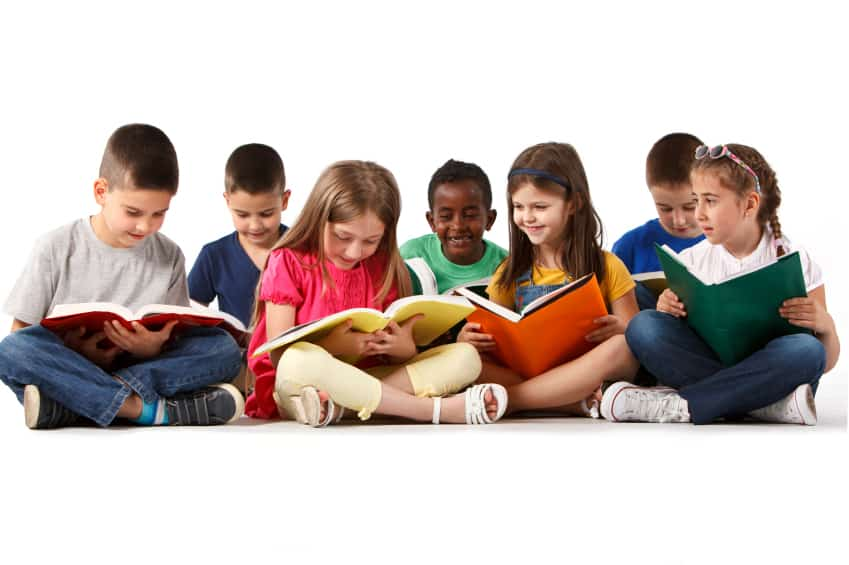 Group of happy school children reading books. Isolated on white background.