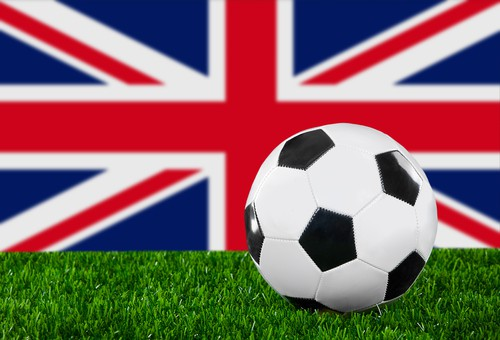 Soccer ball in front of a Union Jack, British Flag
