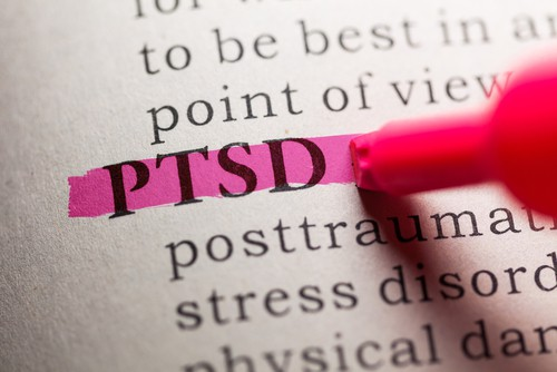 PTSD highlighted in pink in a book.