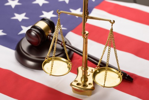 American Flag, gavel, scales of justice