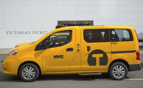 "An eco-friendly and accessible yellow, taxi van with ""NYC"" on the side"