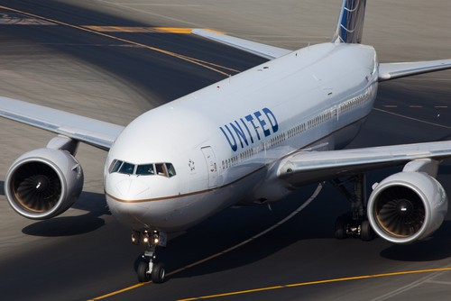 A United Airlines plane as it drives down a runway