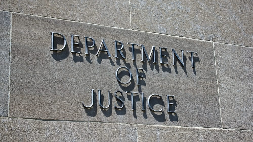 Sign on a wall, Department of Justice