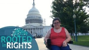 Emily Ladau smiles to the camera in front of the U.S. Capitol