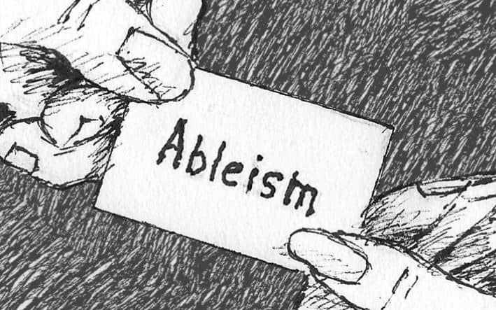 "black and white drawing of a card saying ""Ableism"" being handed from one hand to another"