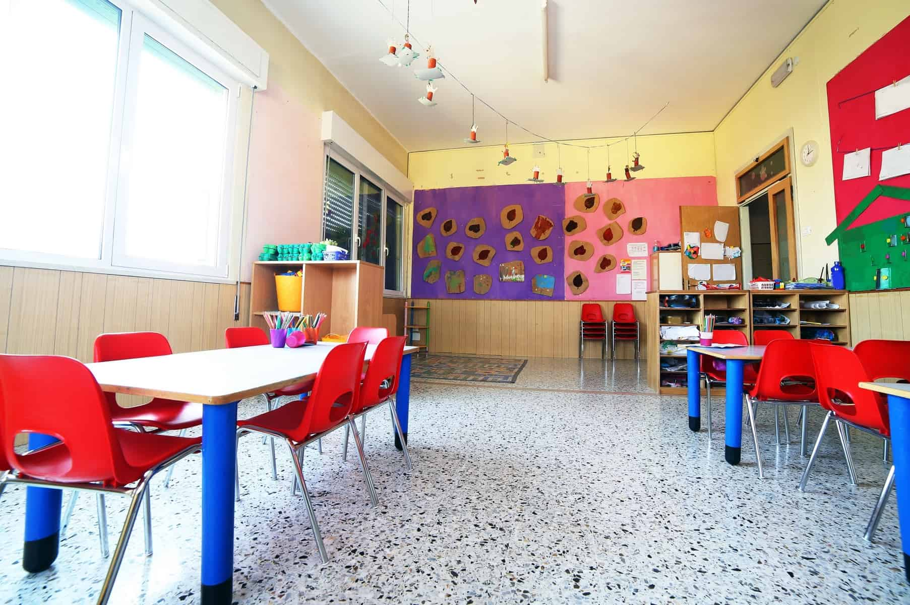 Kindergarten classroom with colorful furniture and art on the walls