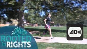 Shot of Emily Harvey running in the park