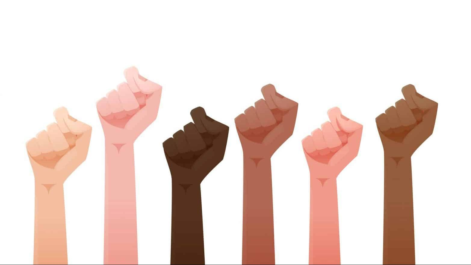 illustration of fists of people of different skin colors raised together in the air.