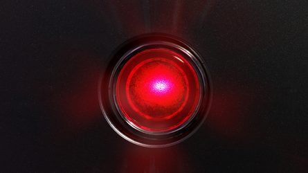 A bright red light shining against a black background.