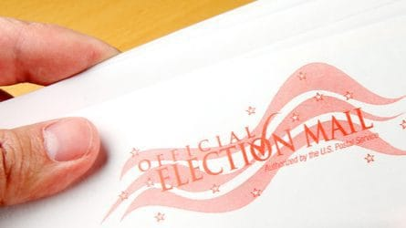 "An envelope that says ""Official Election Mail."""
