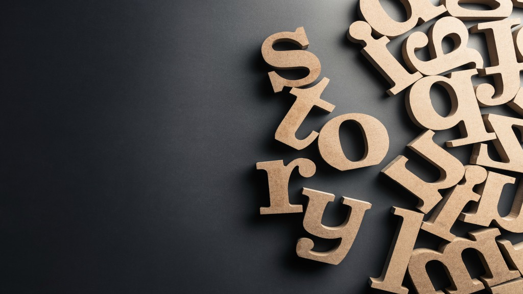 The word story spelled out in wooden letters, surrounded by other randomized wooden letters.
