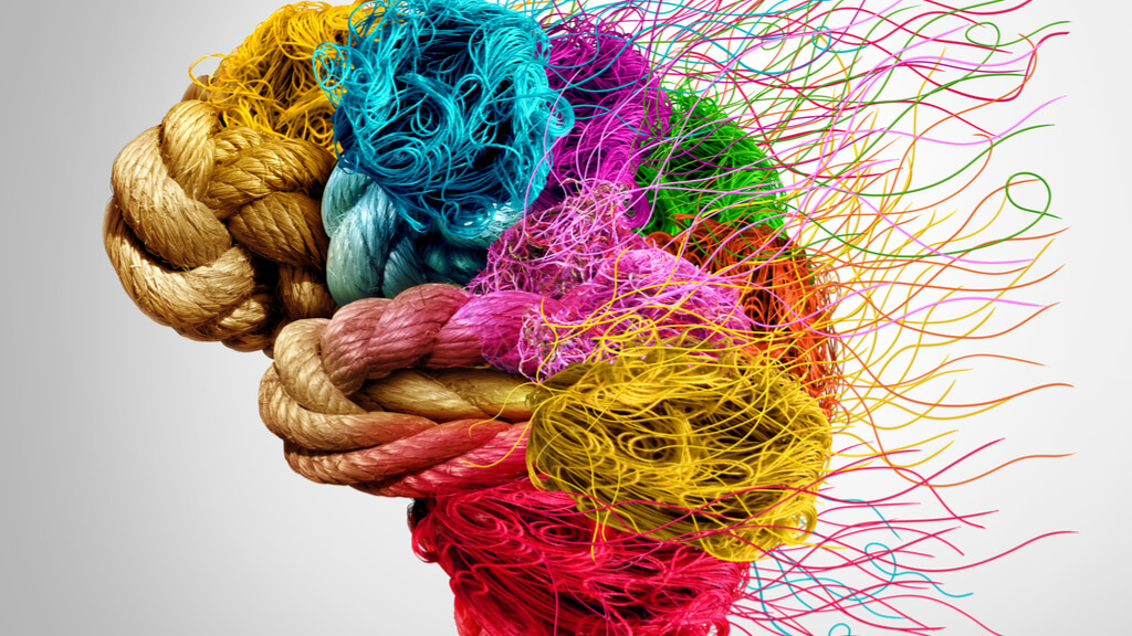 An image of a brain made up of different colored ropes. At the back, the ropes are fraying.