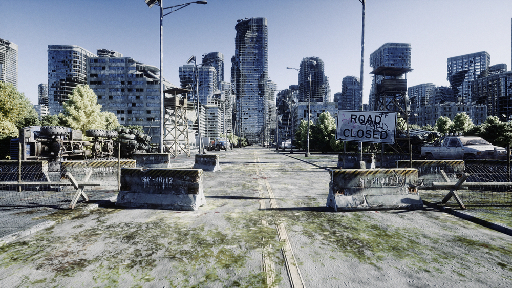 """Post-apocalyptic scene shows deserted city and burned out building with a sign that says """"road closed."""""""