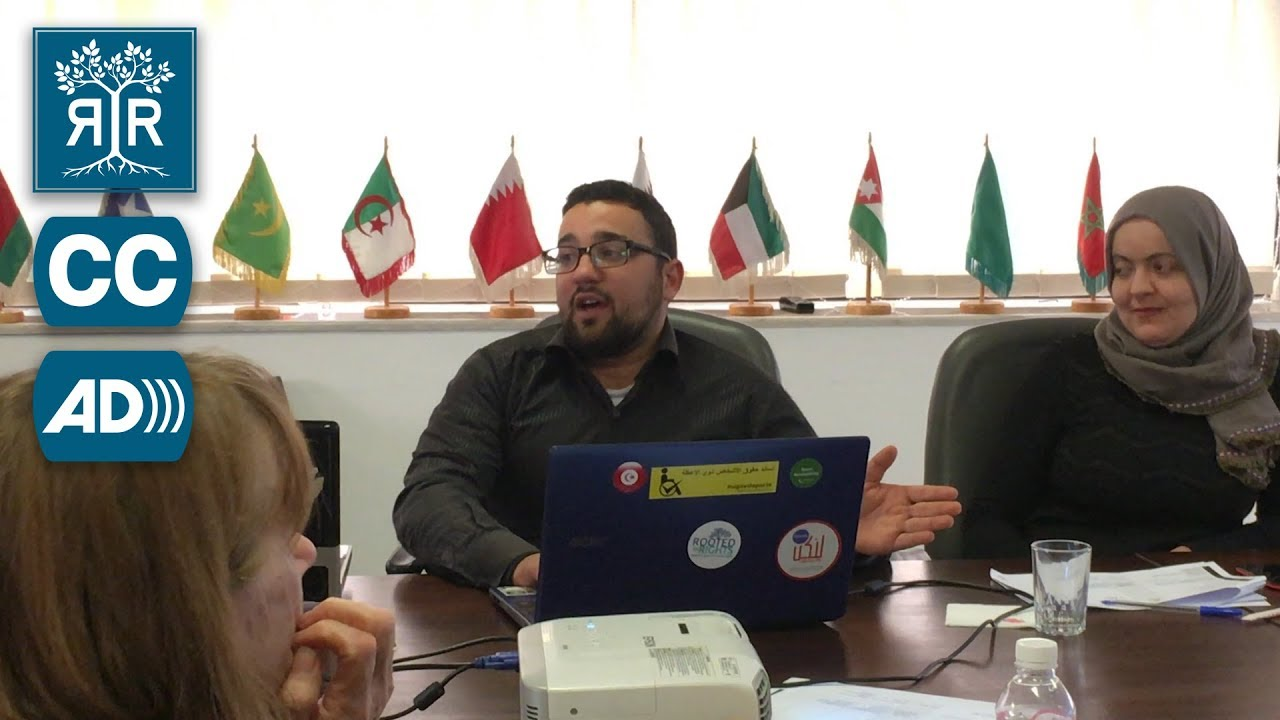 Arbi Chouikh consults with a group of Tunisian disability advocates.