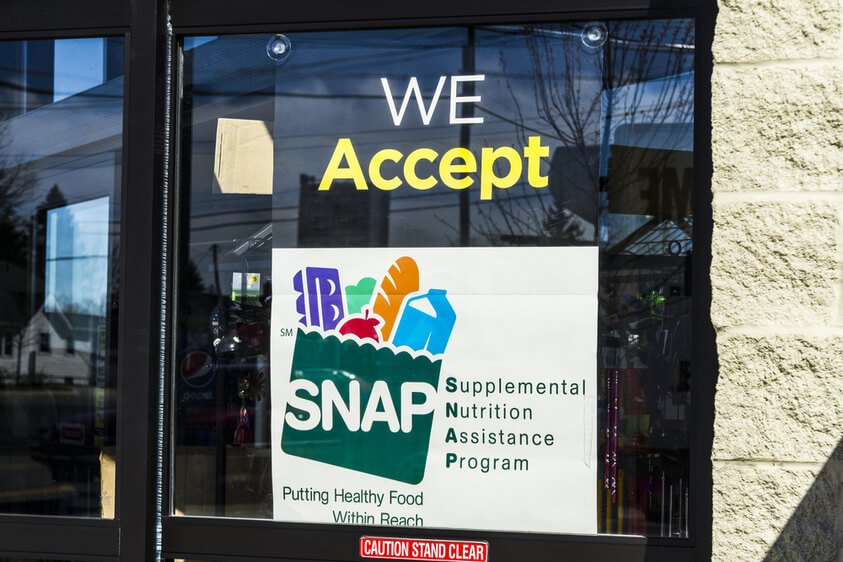 "Photo of grocery store window says ""we accept SNAP"""