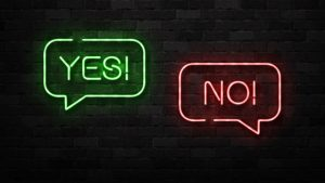 Two neon signs in the shape of speech bubbles. One says yes, one says no.