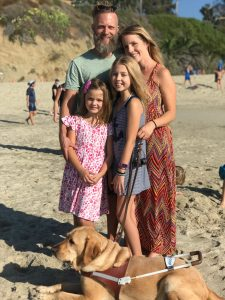 Joy and her family are at the beach.