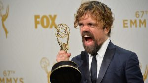 Photo of Peter Dinklage holding an Emmy