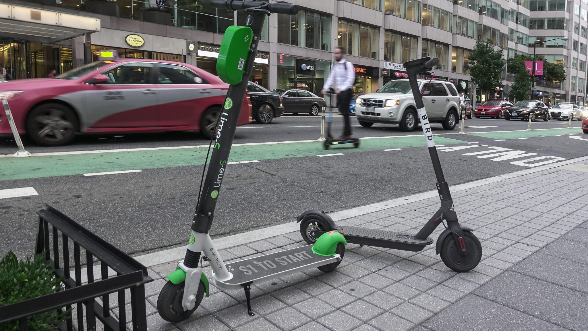 two scooters parked on a sidewalk