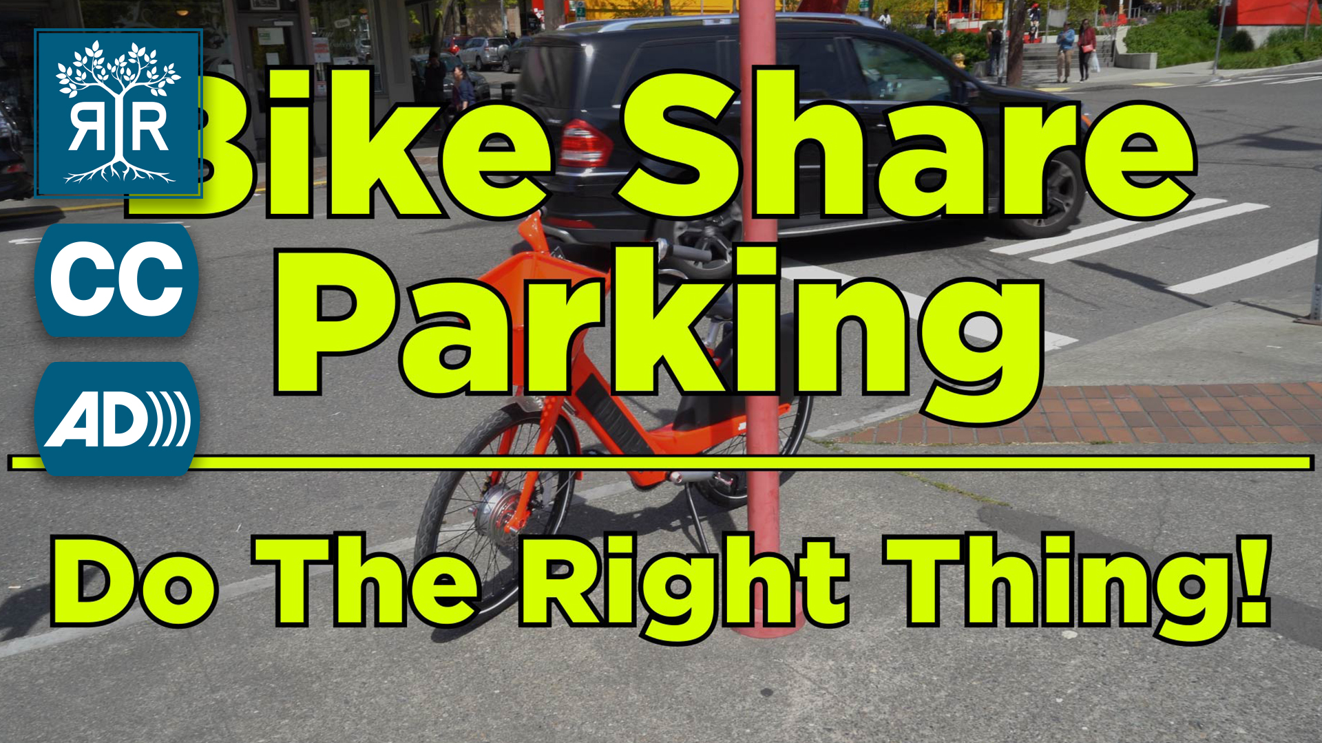 Image of a busy street. A car is in the right lane and a bike is resting against a pole on the sidewalk. The following words appear in yellow font: Bike Share Parking: Do The Right Thing