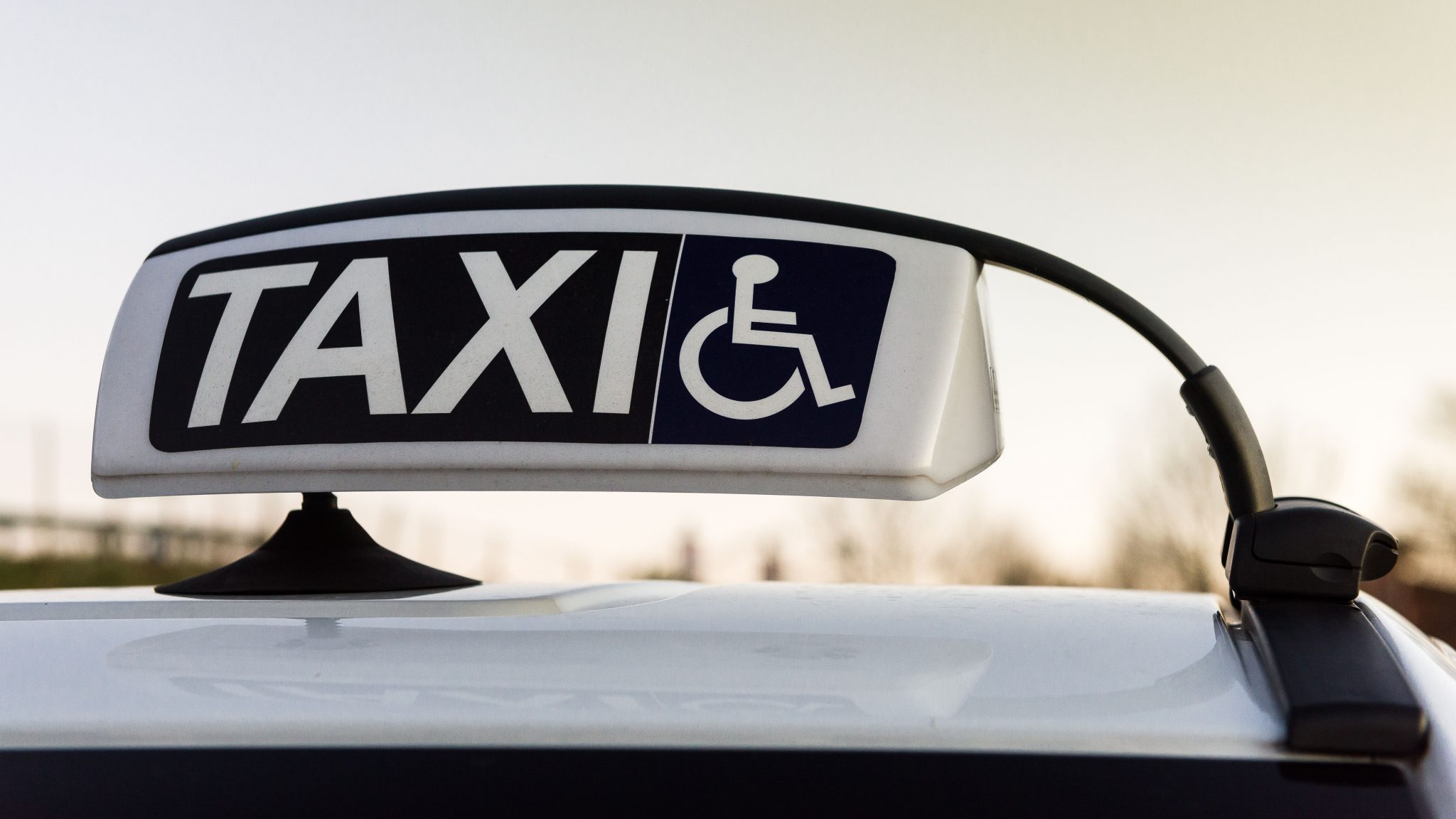 Taxi signage with wheelchair symbol