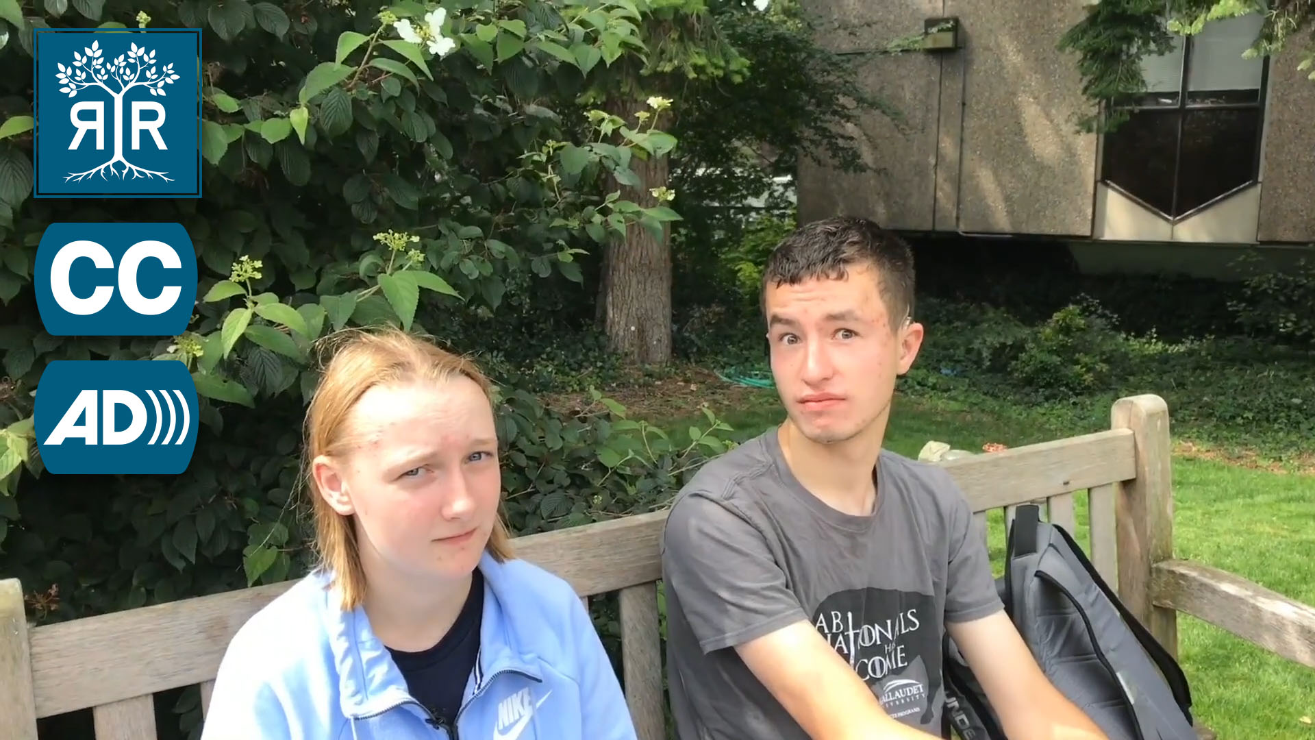 Two students on a bench grimace at the camera.