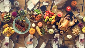 A wooden table filled with Thanksgiving food