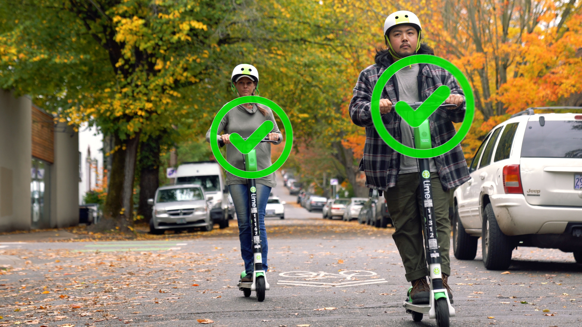 Two people ride Lime scooters and are overlaid with green checkmarks.