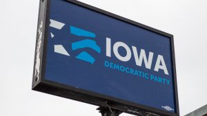 """A big blue sign that says """"Iowa Democratic Party"""""""