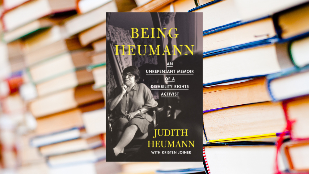 Photo of Judy Heumann's memoir cover superimposed over a background of stacks of books