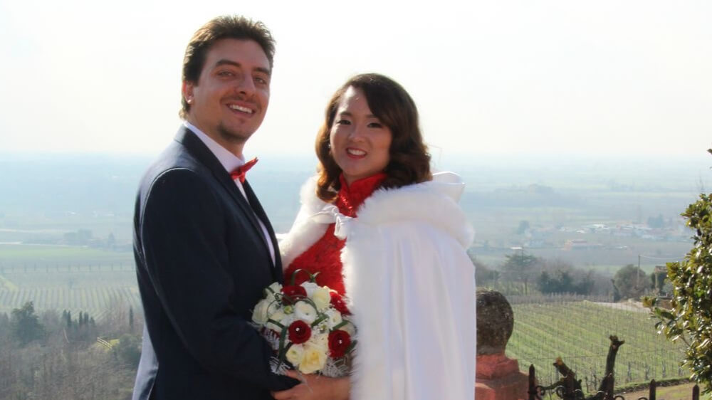 A wedding photo of the author and her husband.
