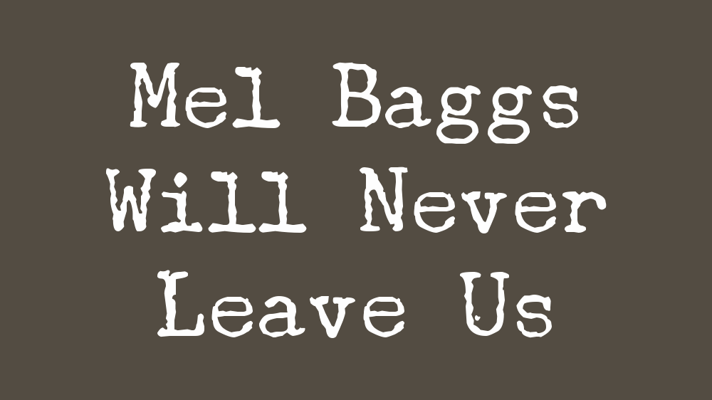 """Text against a dark olive green background reads """"Mel Baggs Will Never Leave Us"""""""
