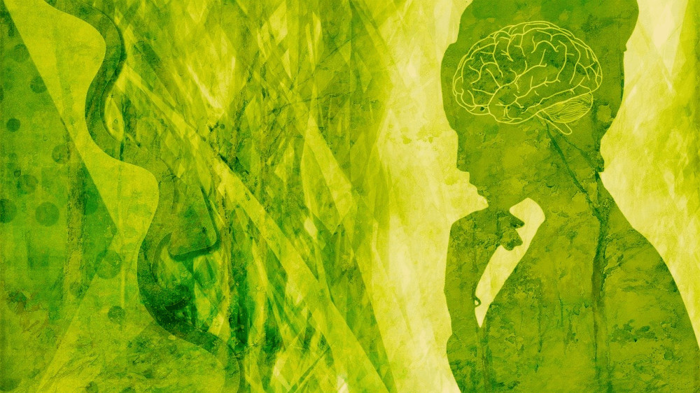 An abstract pattern in hues of green with a silhouette of a person resting their hand pensively on their chin.